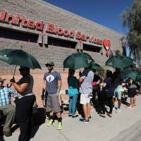 Hundreds of people line up to donate blood following the mass shooting at the Route 91 music festival in Las Vegas Monday. | REUTERS