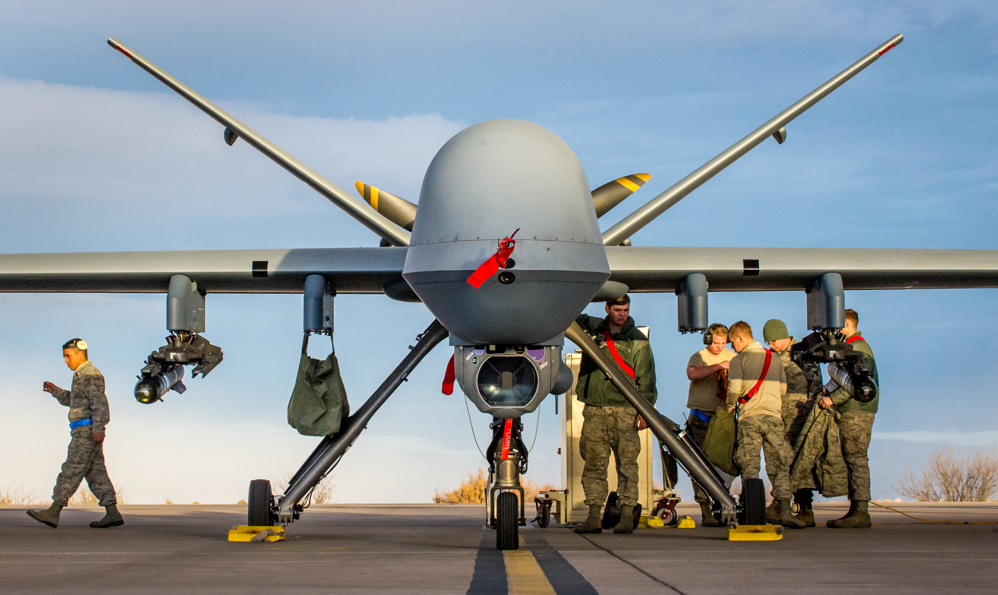U.S. airmen perform a post-flight check of an MQ-9 Reaper drone at Holloman Air Force Base in New Mexico last December. | U.S. AIR FORCE