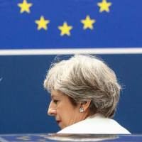 British Prime Minister Theresa May leaves a European leaders summit following two days of meetings in Brussels on Friday. | AFP-JIJI