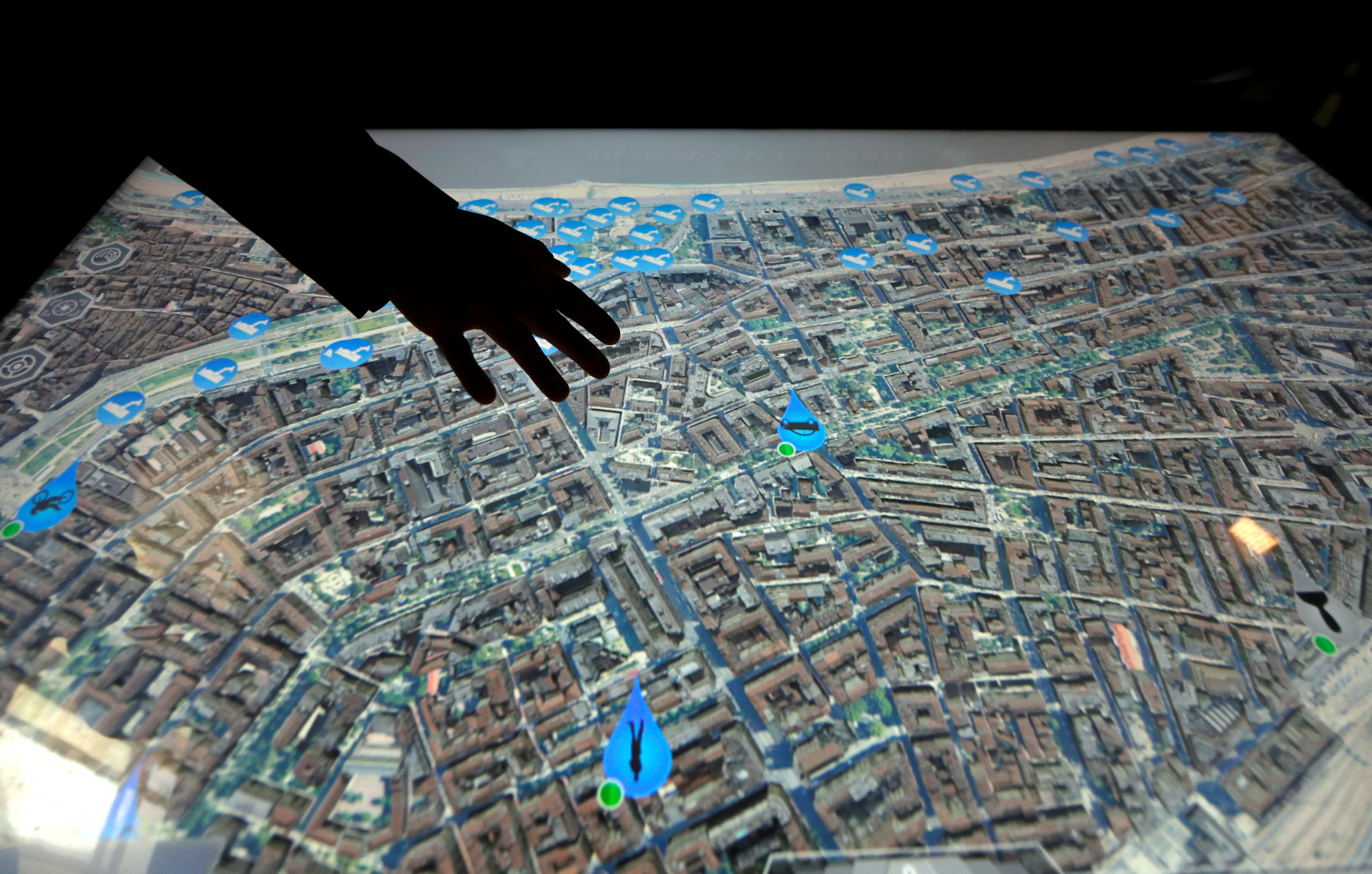 A man uses a tactile table with a street map during a visit by French Interior Minister Gerard Collomb at the municipal police supervision center as part of the Euro-Mediterranean conference of cities on the prevention of radicalization and for the fight against terrorism in Nice, France, Friday. | REUTERS