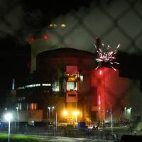 Greenpeace activists enter French nuclear plant and set off fireworks near spent-fuel pool to show vulnerabilities