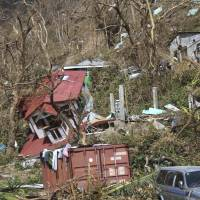 Homes lie scattered after the passing of Hurricane Maria in Roseau, the capital of Dominica, Sept. 23. Lives have been lost around the Caribbean, including on hard-hit Dominica. | AP