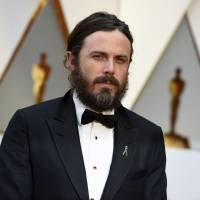 Casey Affleck arrives at the Oscars in Los Angeles in February. Two women who worked on Casey Affleck's film 'I'm Still Here' filed sexual harassment lawsuits against him in 2010. Both claims were settled out of court for an undisclosed amount in 2010. Affleck has repeatedly denied the allegations. He went on to win the best actor Oscar for 'Manchester by the Sea.' | JORDAN STRAUSS / INVISION / VIA AP