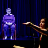 Amanda Friedeman takes a student's question for the hologram of Holocaust survivor Adina Sella at the Illinois Holocaust Museum & Education Center in Skokie on Thursday. | AFP-JIJI