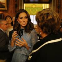 Britain's Kate, the Duchess of Cambridge, talks to guests during a reception at Buckingham Palace, London, to celebrate World Mental Health Day Tuesday. | HEATHCLIFF O'MALLEY / POOL / VIA AP