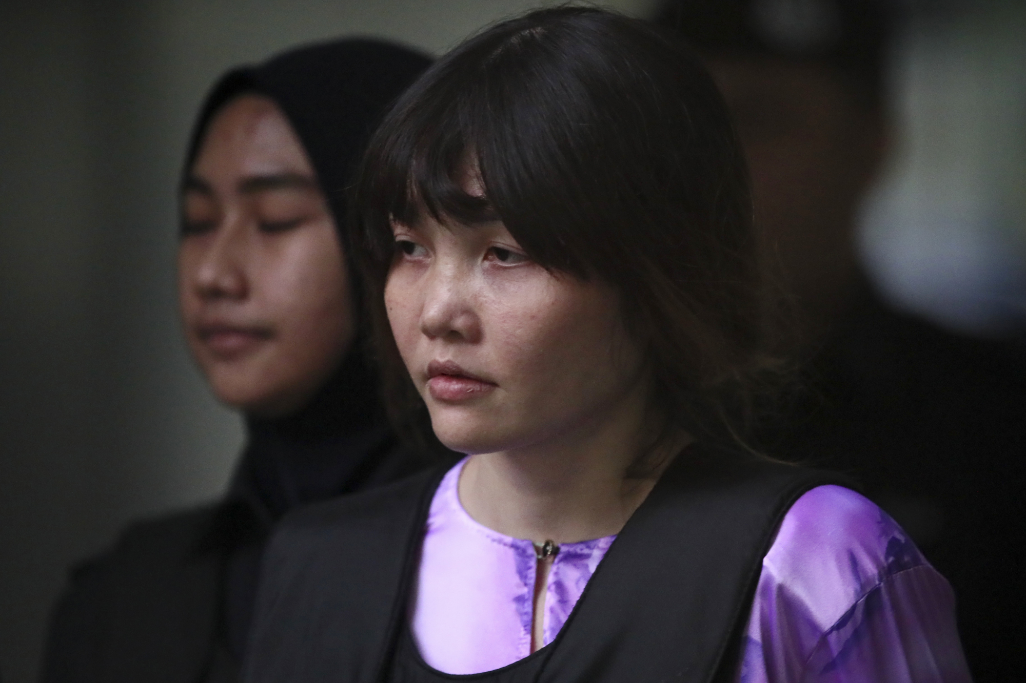 Vietnamese Doan Thi Huong is escorted by police as she leaves after her trial session at the Shah Alam courthouse in Shah Alam, outside Kuala Lumpur Tuesday. | AP