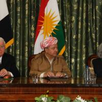 Iraqi President Fuad Masum (left) meets with Iraqi Kurdish President Massud Barzani and Hiro Ibrahim, the wife of the late Iraqi President Jalal Talabani, at Talabani's house in Dokan, some 70 km northwest of Sulaimaniyah. Crisis talks made little headway in resolving an armed standoff between Kurdish and Iraqi forces in the oil-rich northern province of Kirkuk, three weeks after a contested Kurdish independence vote. | AFP-JIJI
