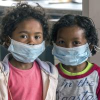 Children wear face masks at a school in Antananarivo, Madagascar, on Oct. 3. A plague outbreak has killed dozens in the island nation, the International Federation of Red Cross and Red Cresent Societies disclosed on Friday. | AP
