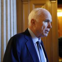Sen. John McCain, R-Ariz., speaks to reporters Thursday on Capitol Hill in Washington. | AP
