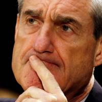 Washington abuzz as Robert Mueller's Russia probe set to file first charges amid Trump diversion ploys