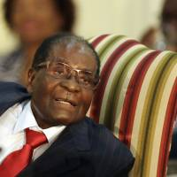 Zimbabwe's President Robert Mugabe meets with South African President Jacob Zuma at the Presidential Guesthouse in Pretoria, South Africa, on Oct. 3. | AP