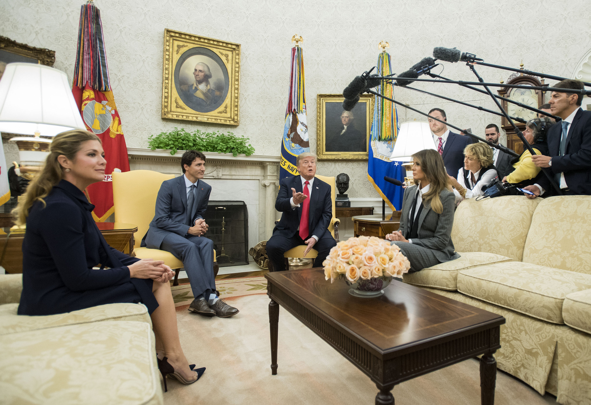 U.S. President Donald Trump meets with Canadian Prime Minister Justin Trudeau in the White House Oval Office on Wednesday. With them are first lady Melania Trump and Trudeau's wife, Sophie Gregoire Trudeau.   BLOOMBERG