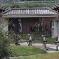 U.S. soldiers conduct a joint exercise with South Korean forces at the Rodriquez Multi-Purpose Range Complex in Pocheon, South Korea, on Sept. 19. | AP