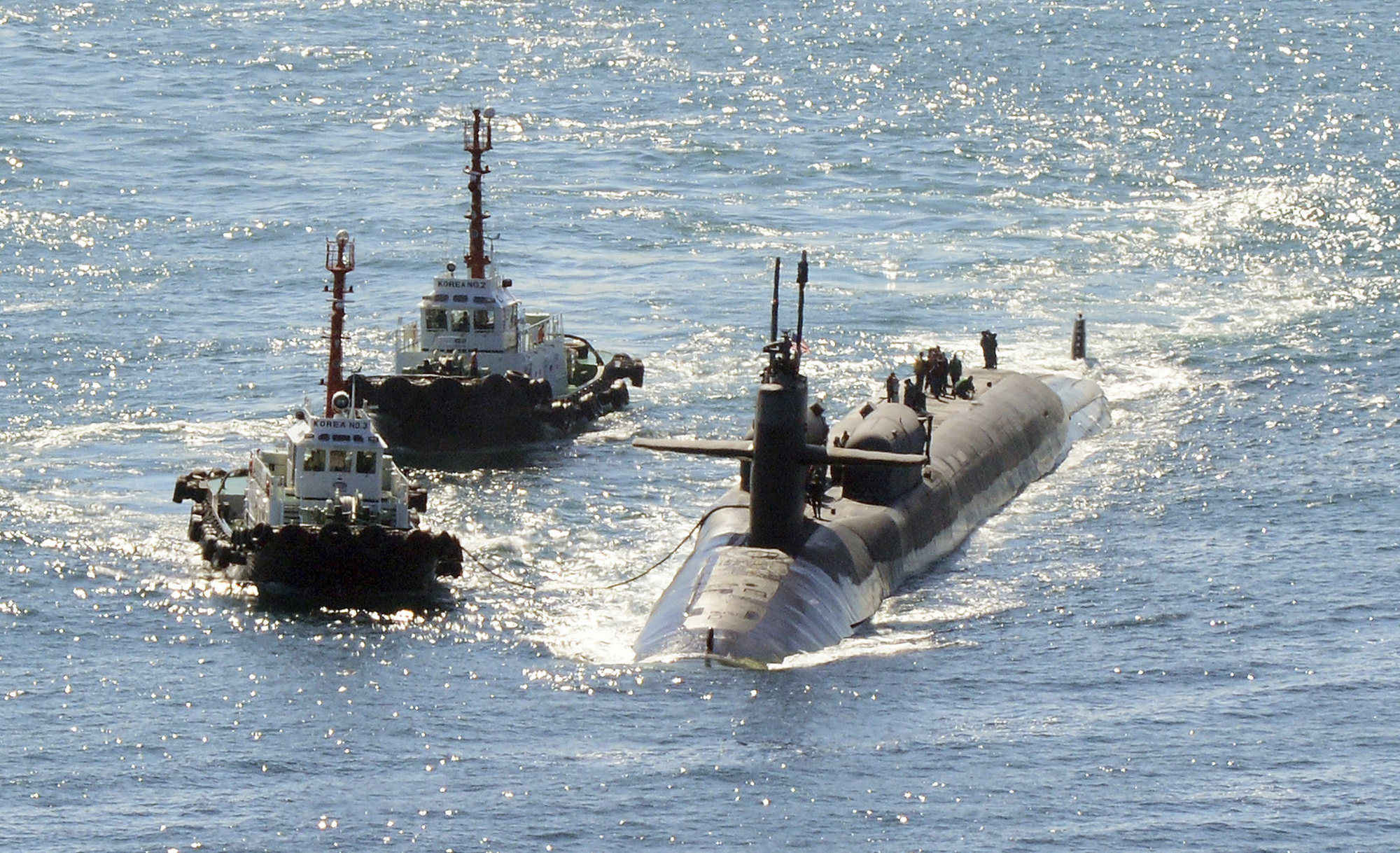 The nuclear-powered submarine USS Michigan approaches a naval base in Busan, South Korea, on Friday. | NEWSIS / VIA AP