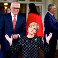 Australian Prime Minister Malcolm Turnbull watches as Foreign Minister Julie Bishop reacts after an official ceremony to swear in members of the government in Canberra in July 2016. | REUTERS