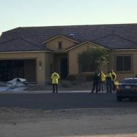 In this photo provided by the Mesquite, Nevada, Police Department, police personnel stand outside the home of Stephen Paddock on Monday in Mesquite. Police identified Paddock as the gunman at a music festival Sunday evening. | MESQUITE POLICE / VIA AP