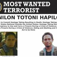 An FBI wanted poster shows Isnilon Hapilon, who was purportedly the designated leader of the Islamic State group's Southeast Asia branch in 2016 but has long ties to local extremist movements. Philippine security officials said Hapilon and fellow militant leader Omarkhayam Maute were killed in a gunbattle and their bodies were found Monday in Marawi, Philippines. | AP