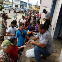 Puerto Rico masses into survival struggle amid acute shortages, 11 days after devastating hurricane
