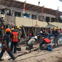 Search and rescue efforts are conducted at the Enrique Rebsamen school in Mexico City, on Sept. 21, two days after a magnitude 7.1 earthquake killed more than 350 people. | AP