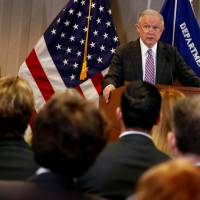U.S. Attorney General Jeff Sessions delivers remarks on the U.S. system for asylum-seekers at the Executive Office for Immigration Review in Falls Church, Virginia, Thursday. | REUTERS