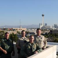 Las Vegas police officers who were part of the MACTAC (Multi-Assault Counter-Terrorism Action Capabilities) team that went into the Mandalay Bay Resort and Casino during the Route 91 music festival mass shooting pose for a photo in Las Vegas Wednesday. | REUTERS