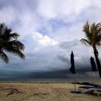 Black clouds are seen on the horizon from a beach in Cancun, Mexico, on Friday, ahead of the passage of Tropical Storm Nate. | AFP-JIJI