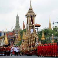 The Great Victory Chariot is pulled during the funeral procession for Thailand's late King Bhumibol Adulyadej before the Royal Cremation Ceremony in front of the Grand Palace in Bangkok Thursday. | REUTERS
