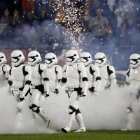 Stormtroopers march down the field during the halftime of an NFL football game between the Chicago Bears and the Minnesota Vikings on Monday in Chicago. | AP