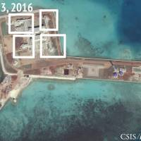 A satellite image shows apparent Chinese anti-aircraft guns and close-in weapons systems on the artificial island atop Hughes Reef in the South China Sea in this image released on Dec. 13, 2016. | REUTERS