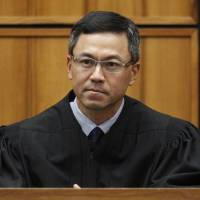 Judge in Hawaii blocks latest version of Trump's travel ban hours before it takes effect