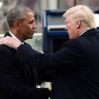 U.S. President Barack Obama shakes hands with President-elect Donald Trump during the presidential inauguration at the Capitol in Washington on Jan. 20. | AFP-JIJI