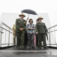 Taiwan President Tsai Ing-wen exits the USS Arizona Memorial with National Park Services officials in Honolulu on Saturday. | AP