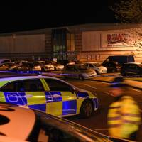 Gunman treated and arrested after taking pair hostage at U.K. bowling alley; terrorism ruled out