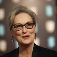 Actress Meryl Streep poses for photographers upon arrival at the British Academy Film Awards in London Feb. 12. Streep called the reports of sexual harassment against Harvey Weinstein 'disgraceful' and said she was unaware of the alleged incidents, in a statement Monday to the Huffington Post. Streep said 'The behavior is inexcusable but the abuse of power familiar.' | VIANNEY LE CAER / INVISION / VIA AP