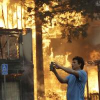 Wildfires rip through California wine country, leaving 10 dead and destroying at least 1,500 homes