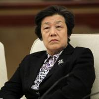 Justice Minister Wu Aiying attends a meeting during the National People's Congress and Chinese People's Political Consultative Conference in Beijing on March 7, 2013. | REUTERS