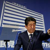 Prime Minister Shinzo Abe, who is also leader of the Liberal Democratic Party, is seen at a news conference at LDP headquarters in Tokyo on Monday. | REUTERS