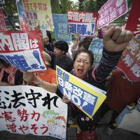 Protesters gather in front of the Diet building after the Lower House was dissolved in Tokyo on Sept. 28. | AP