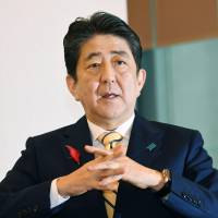 Prime Minister Shinzo Abe speaks during an interview at his office in Tokyo on Friday. | KYODO