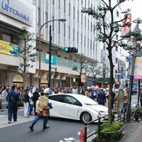 A car is seen near where it crashed into a guardrail Friday after hitting pedestrians in front of the Tokyu Department Store in Kichijoji in western Tokyo. | KYODO