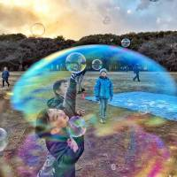 Russian diplomat's photo of children blowing bubbles takes top prize in Tokyo competition