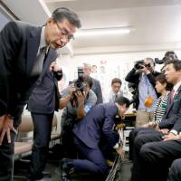 Masaru Wakasa, one of the founders of Kibo no To (Party of Hope), bows to supporters after losing his Lower House seat Sunday. | KYODO