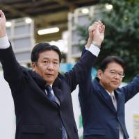 Yukio Edano (left), leader of the newly established Constitutional Democratic Party of Japan, and Akira Nagatsuma, who plans to run in the upcoming Lower House poll on the CDP ticket, appear before voters Wednesday in Tokyo's Nakano Ward. | KYODO