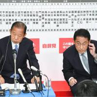 Liberal Democratic Party heavyweights Toshihiro Nikai (left) and Fumio Kishida take questions in a television interview at the party's headquarters in Tokyo. | KYODO