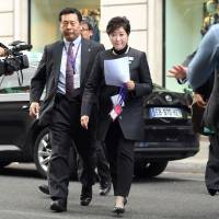 Tokyo Gov. Yuriko Koike walks in Paris on Monday. She was in the city to attend a meeting of C40, a network of the world's megacities committed to addressing climate change. | KYODO