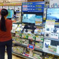 A variety of dashcams are displayed at a major auto parts and accessories retailer in Tokyo's Koto Ward earlier this month. | KYODO