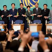 The leaders of Japan's major political parties pose for photographers at the Japan National Press Club in Tokyo on Sunday during a debate ahead of the Oct. 22 Lower House election. | AFP-JIJI