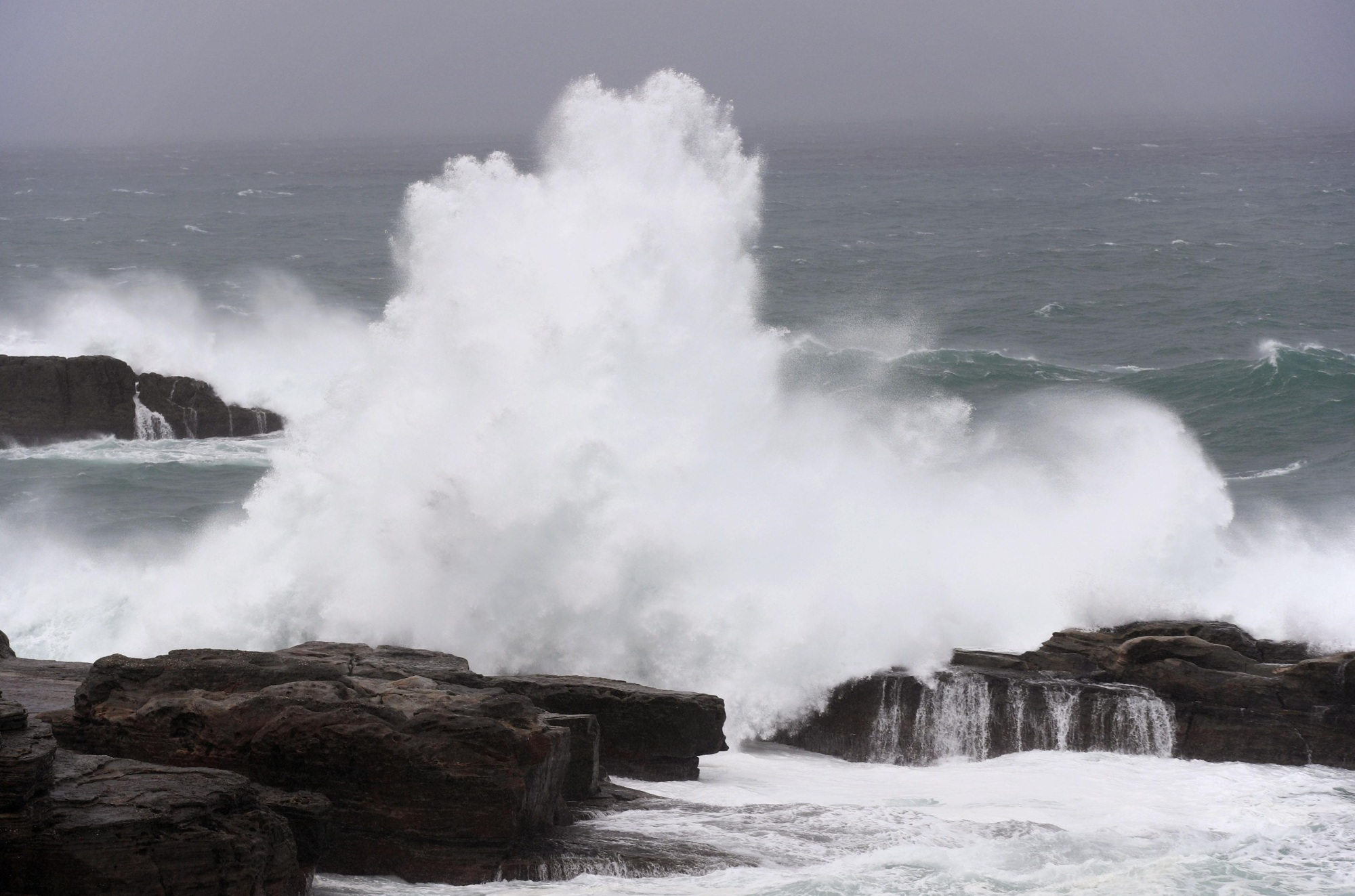 High waves batter the coast of Shirahama, Wakayama Prefecture, on Sunday as Typhoon Lan approached. Municipalities with remote islands were unable to start tallying votes as the powerful storm halted ferry services, preventing ballots from being delivered to the mainland. | KYODO