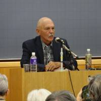 Craig Anderson, a former U.S. seaman who deserted during the Vietnam War with the help of a Japanese pacifist group, gives a speech at Rikkyo University in Tokyo on Saturday — his first visit to Japan in 50 years. | KYODO