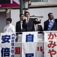 Prime Minister Shinzo Abe delivers a speech during a campaign appearance in Saitama on Wednesday. | AFP-JIJI